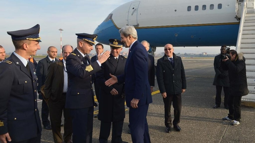 U.S. Secretary of State John Kerry, center right, is greeted upon arrival at Ciampino Airport near Rome Sunday, Dec. 13, 2015. Kerry is in Rome for a high-level gathering on the crisis in Libya. (Mandel Ngan/Pool Photo via AP)