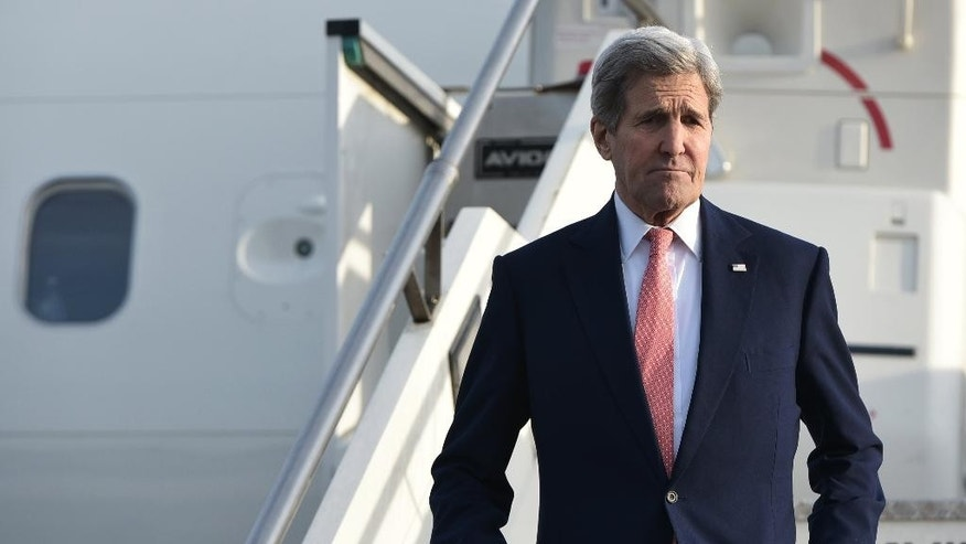 U.S. Secretary of State John Kerry steps off a plane upon arrival at Ciampino Airport near Rome Sunday, Dec. 13, 2015. Kerry is in Rome for a high-level gathering on the crisis in Libya. (Mandel Ngan/Pool Photo via AP)