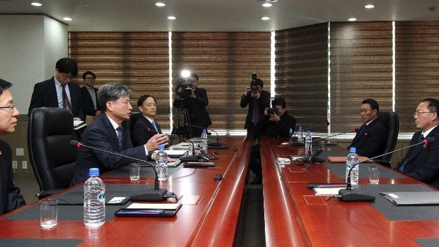 Hwang Boogi, second from left, South Korea's vice minister of unification and the head negotiator for high-level talks with North Korea, talks as his North Korean counterpart Jon Jong Su, second from right, listens during their meeting at the Kaesong Industrial Complex in Kaesong, North Korea, Friday, Dec. 11, 2015. North and South Korea on Friday held high-level talks at a North Korean border town, a small step meant to improve ties battered by a military standoff in August and decades of acrimony and bloodshed. (Korea Pool/Yonhap via AP) KOREA OUT
