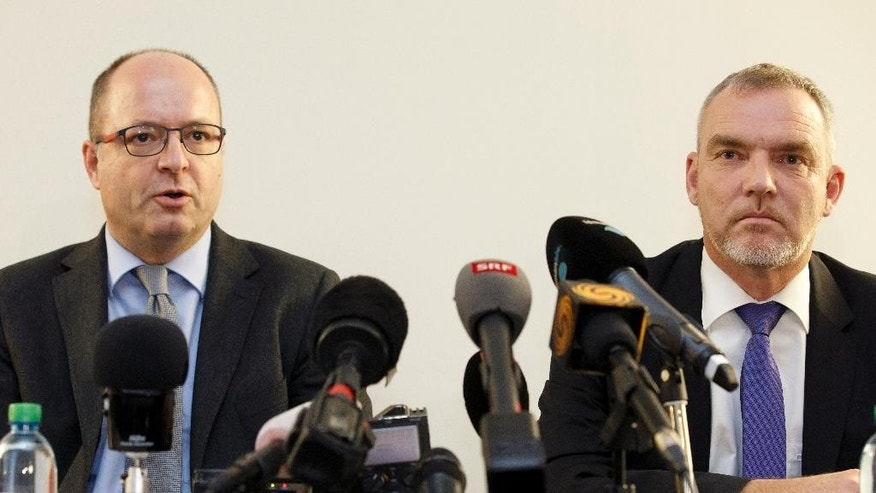 Olivier Jornot, left, Prosecutor General of the Canton of Geneva, and Francois Schmutz, right, Chief of the Judicial police of  the Canton of Geneva, inform the media about two individuals    arrested by Swiss police Friday , during press conference, in Geneva, Switzerland, Saturday, Dec. 12, 2015.  (Salvatore Di Nolfi/Keystone via AP)