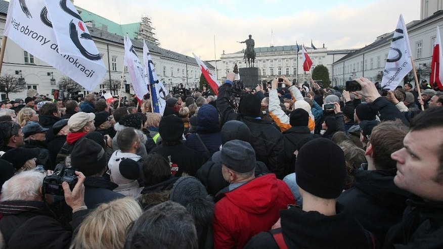 Tens of thousands of Poles angered by an ongoing constitutional conflict march in Warsaw, Poland on Saturday, Dec. 12, 2015, to protest against the role that President Andrzej Duda and the new conservative government have had in the swelling discord. (AP Photo/Czarek Sokolowski)