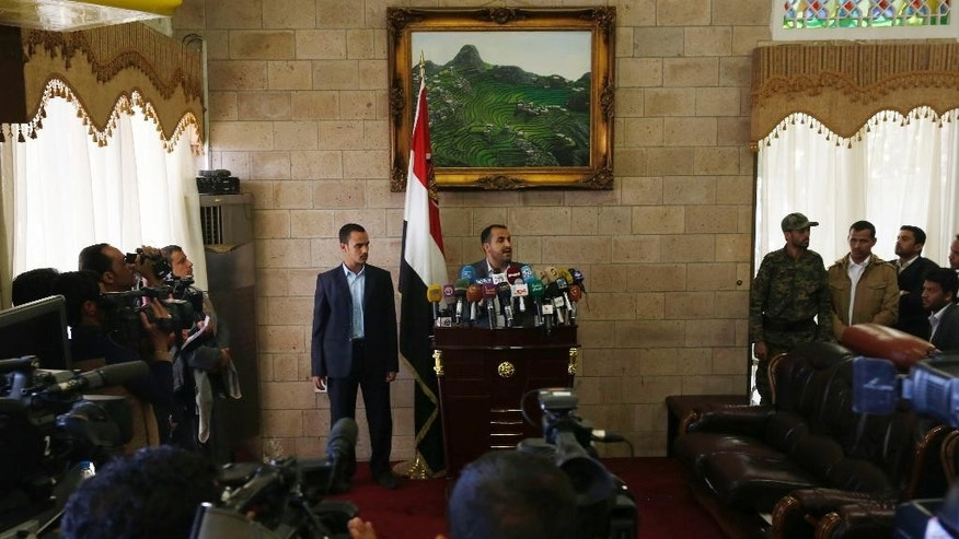 The spokesman of the Shiite rebels known as Houthis, Mohammed Abdel Salam, center, speaks at a press conference prior to the departure of the Houthi delegation for the Geneva peace talks, in Sanaa, Yemen, Saturday, Dec. 12, 2015. The fighting in Yemen pits the Houthis and troops loyal to former President Ali Abdullah Saleh against southern separatists, local and tribal militias, Sunni Islamic militants and President Hadi's loyalists. (AP Photo/Hani Mohammed)