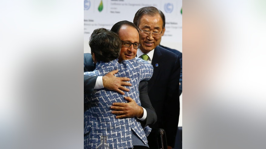 CORRECTS SPELLING OF HOLLANDE, NOT HIOLLANDE - United Nations Secretary General Ban Ki-moon, right, watches French President Francois Hollande hugging  United Nations climate chief Christiana Figueres after the final conference of the COP21, the United Nations conference on climate change, in Le Bourget, north of Paris, Saturday, Dec.12, 2015. Nearly 200 nations adopted the first global pact to fight climate change on Saturday, calling on the world to collectively cut and then eliminate greenhouse gas pollution but imposing no sanctions on countries that don't. (AP Photo/Francois Mori)