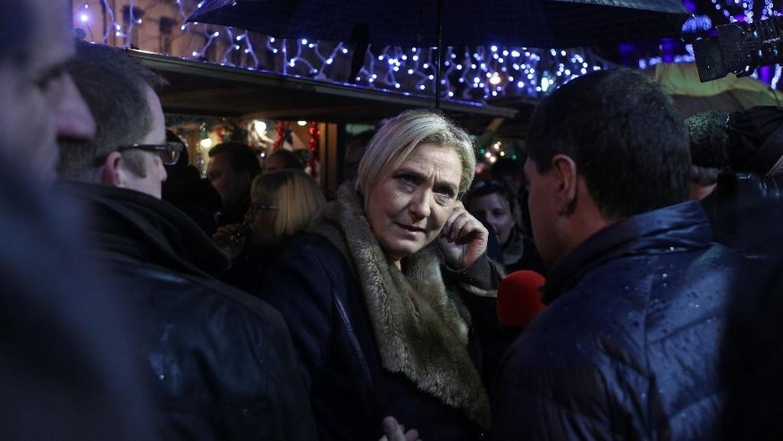 French far-right party leader Marine Le Pen visits the Christmas market in Henin-Beaumont, northern France, Friday, Dec. 11, 2015.  Le Pen is in the race for the presidency of the French northern region. The second round of the regional elections will take place Sunday. (AP Photo/Michel Spingler)