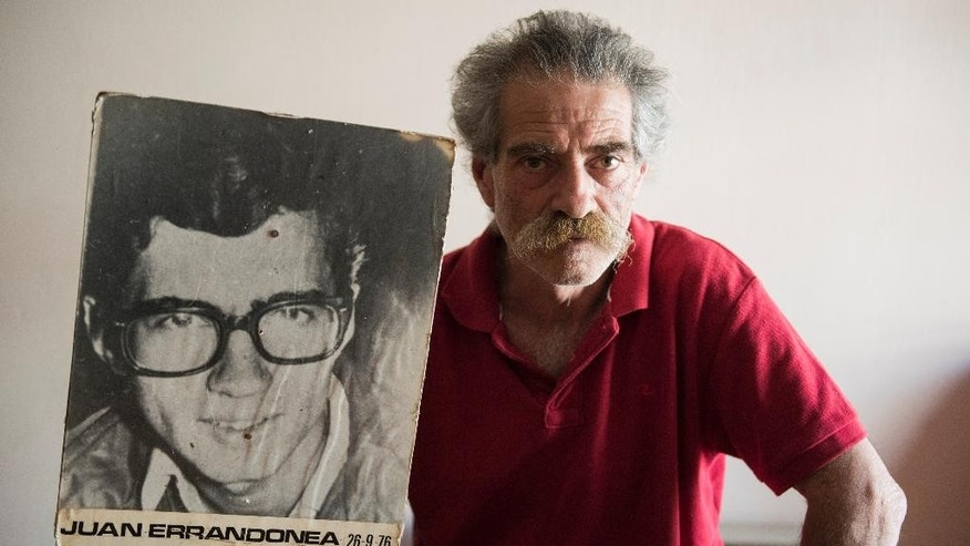 In this Dec. 4, 2015 photo, Ignacio Errandonea holds a picture of his brother, Juan Errandonea, dissapeared during the Uruguayan dictatorship, after an interview with the Associated Press in Montevideo, Uruguay, Friday. Ignacio Errandonea has been searching 39 years for a brother who went missing in the 1970s as military dictatorships swept across South America. (AP Photo/Matilde Campodonico)