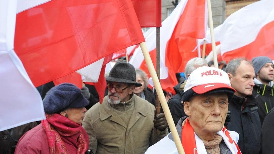 Thousands of backers of Poland's ruling conservative party are marching   to show their support for its policy amid a growing political conflict, in Warsaw, Poland, Sunday, Dec. 13, 2015. The march, led by Law and Justice party head Jaroslaw Kaczynski, comes a day after tens of thousands of government opponents demonstrated in Warsaw and elsewhere, saying the ruling party and President Andrzej Duda are threatening democracy. (AP Photo/Alik Keplicz)