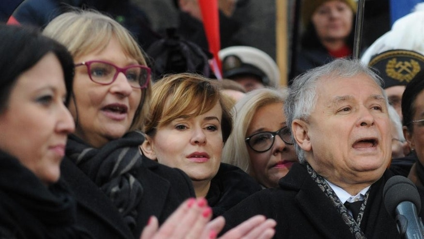 The ruling Law and Justice party head Jaroslaw Kaczynski addresses thousands of supporters  prior to a march  in Warsaw, Poland, Sunday, Dec. 13, 2015. The march, led by  Jaroslaw Kaczynski comes a day after tens of thousands of government opponents demonstrated in Warsaw and elsewhere, saying the ruling party and President Andrzej Duda are threatening democracy. (AP Photo/Alik Keplicz)