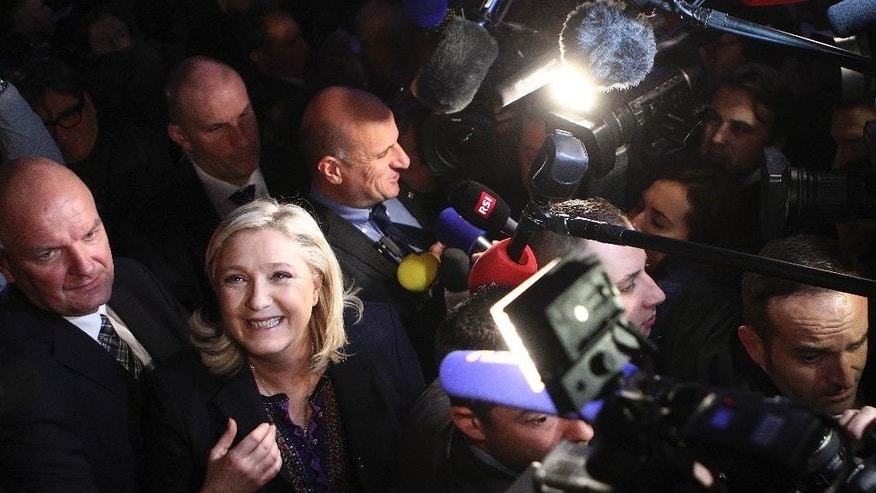 Far Right National Front party leader Marine Le Pen leaves after the second round of the regional elections in Henin-Beaumont, northern France, Sunday Dec.13, 2015. Marine Le Pen's far-right National Front collapsed in French regional elections Sunday after dominating the first round of voting, according to pollsters' projections. (AP Photo/Michel Spingler)