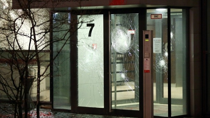 Dec. 12, 2015: Paint and broken glass are seen in the entrance area of an office building in Hamburg, Germany.