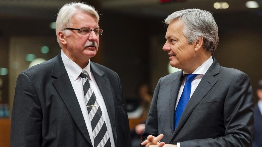 Poland's Foreign Minister Witold Waszczykowski, left, talks with Belgium's Foreign Minister Didier Reynders during an EU foreign ministers meeting at the EU Council building in Brussels Monday, Dec. 14, 2015. (AP Photo/Geert Vanden Wijngaert)