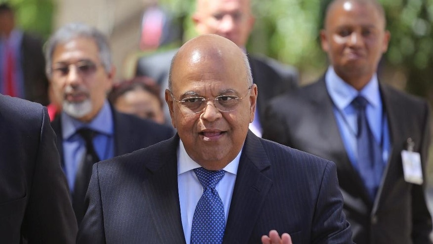 FILE - In this Feb. 26, 2014 file photo, former South African Finance Minister Pravin Gordhan arrives for the yearly South African budget speech in Parliament in Cape Town, South Africa. Gordhan who previously served as the minister from 2009 to 2014, was reappointed finance minister by President Jacob Zuma Sunday, Dec. 13, 2015 after firing Nhlanhla Nene and then David van Rooyen who was sworn in last week, succeeding Nene. (AP Photo/Schalk van Zuydam, File)