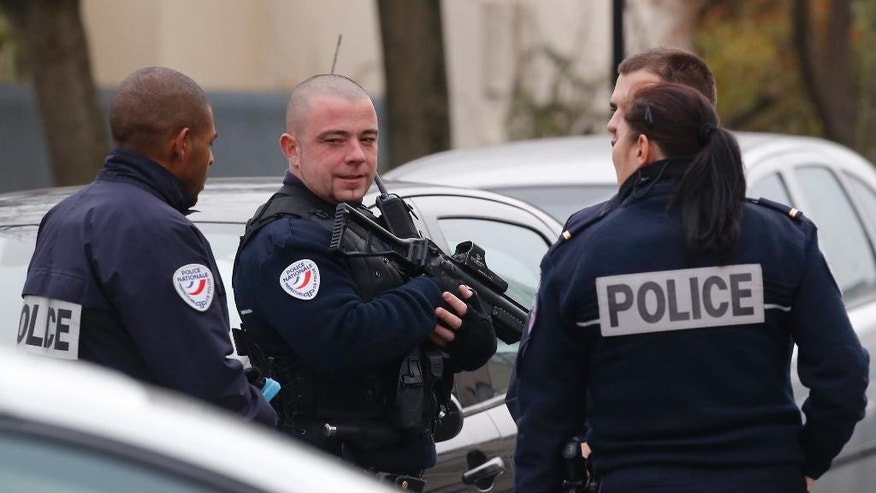 Police officers patrol near a pre-school, after a masked assailant with a box-cutter and scissors who mentioned the Islamic State group attacked a teacher, Monday, Dec.14, 2015 in Paris suburb Aubervilliers. The assailant remains at large, and the motive for the attack is unclear, authorities said. (AP Photo/Michel Euler)