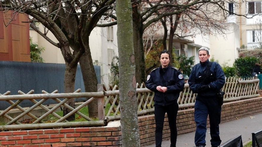 Police officers patrol near a Paris suburb Aubervilliers pre-school, after a masked assailant with a box-cutter and scissors who mentioned the Islamic State group attacked a teacher, Monday, Dec.14, 2015. The assailant remains at large, and the motive for the attack in the town of Aubervilliers is unclear, authorities said. (AP Photo/Michel Euler)