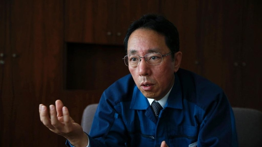 In this Monday, Dec. 14, 2015 photo, Naohiro Masuda, chief of decontamination and decommissioning of the Fukushima Daiichi nuclear plant for its owner Tokyo Electric Power Co. (TEPCO), talks during an interview at the TEPCO headquarters in Tokyo. Masuda, the man leading the daunting task of dealing with the nuclear plant that sank into meltdowns in northeastern Japan, warns with surprising candor: Nothing can be promised. (AP Photo/Koji Ueda)