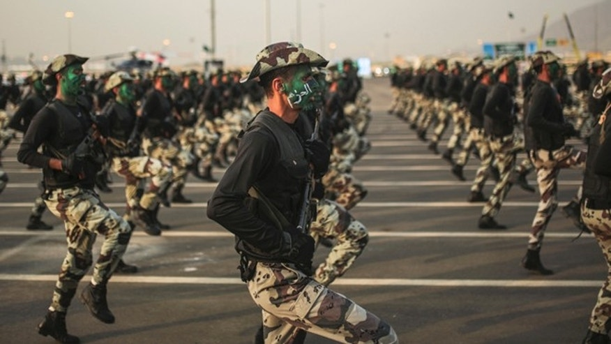 "Sept. 17, 2015: Saudi security forces, whose faces display the word ""Decisive"" take part in a military parade in preparation for the annual Hajj pilgrimage in Mecca, Saudi Arabia."