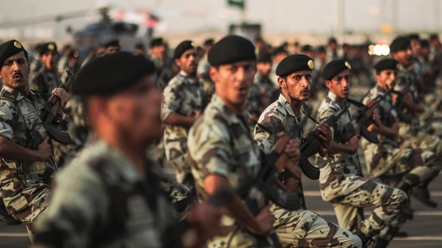 FILE - In this Thursday, Sept. 17, 2015 file photo, Saudi security forces take part in a military parade in preparation for the annual Hajj pilgrimage in Mecca, Saudi Arabia.