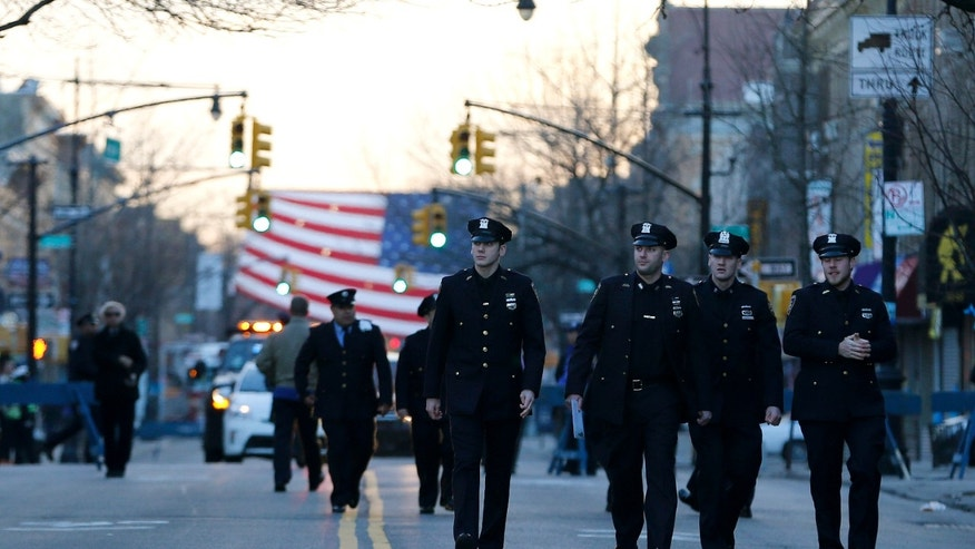 NYPD officers attend funeral services for officer Rafael Ramos on Saturday, Dec. 27, 2014, in New York.