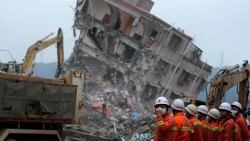 Dec. 22, 2015: Rescuers search for potential survivors near damaged buildings following a landslide at an industrial park in Shenzhen, in south China's Guangdong province. (AP)