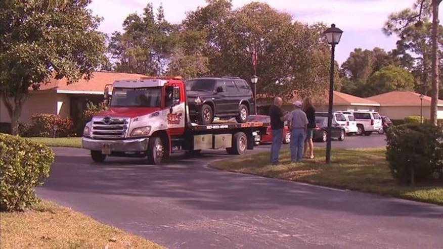 The  Gomez Poehlmann SUV being removed from the family garage. (Photo: WTVT, Fox 13)