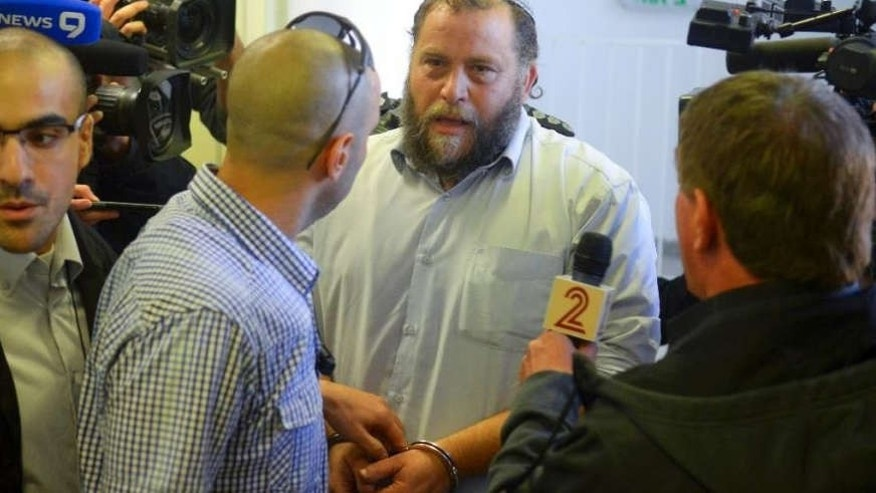 Dec. 16, 2014: Bentzi Gopstein, leader of the extreme right-wing movement Lehava, is handcuffed as he arrives for his hearing at a Jerusalem Court.