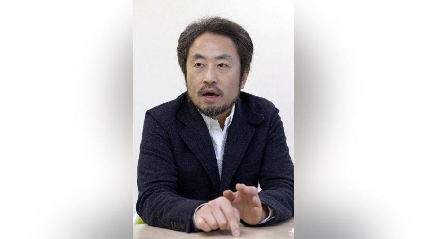 In this Feb. 18, 2015 photo, Japanese freelance journalist Jumpei Yasuda speaks during an interview in Tokyo.