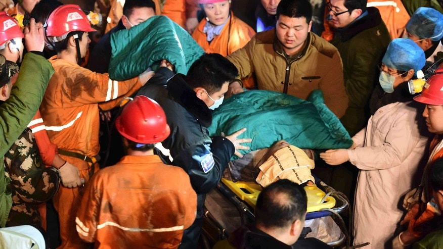In this Dec. 25, 2015 photo released by China's Xinhua News Agency, a trapped miner is rescued from a collapsed gypsum mine in Pingyi County, east China's Shandong Province.