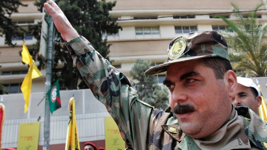 FILE - In this July 17, 2008, file photo, released prisoner Samir Kantar salutes people as he arrives to pay respect at the grave of slain top Hezbollah military commander Imad Mughniyeh, south of Beirut, Lebanon.
