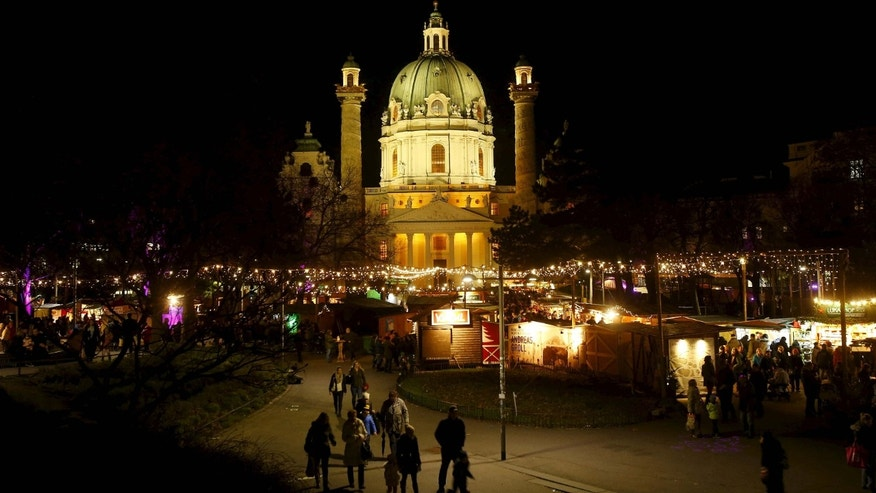 "Dec. 22, 2015: A view of ""Christkindlmarkt"" Advent market in front of Karlskirche church in Vienna, Austria"