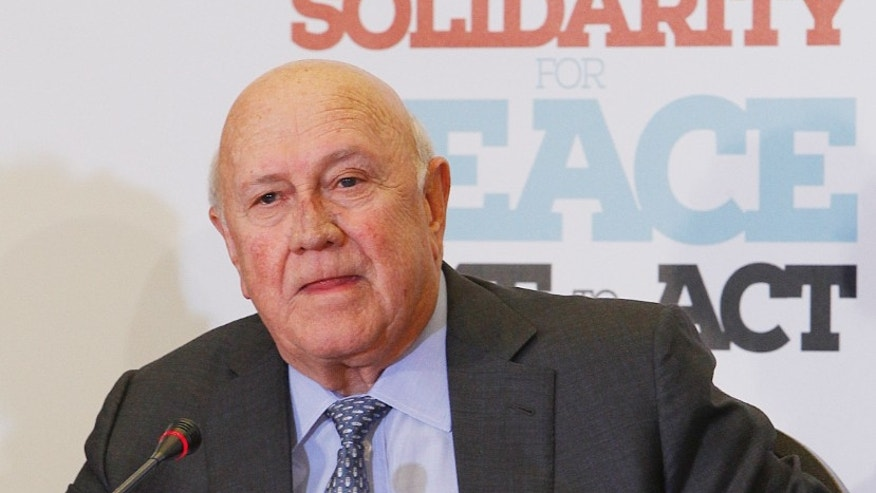 Former President of the Republic of South Africa F. W. de Klerk speaks at a news conference in Poland.