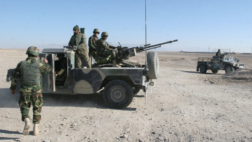 Dec. 23, 2015: Afghan National Army soldiers guard at a checkpoint on the way to the Sangin district of Helmand province, Afghanistan