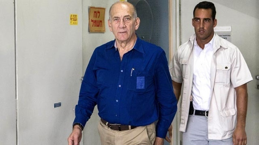 May 13, 2014: Israel's former Prime Minister Ehud Olmert arrives for his trial at the Tel Aviv District Court. (AP Photo/Jack Guez, Pool)