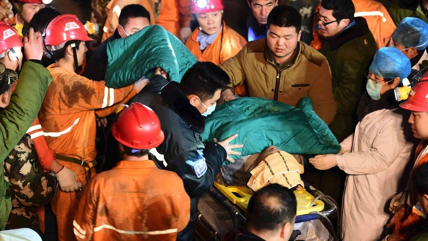 Dec. 25, 2015: In this  photo released by China's Xinhua News Agency, a trapped miner is rescued from a collapsed gypsum mine in Pingyi County, east China's Shandong Province. (Guo Xulei/Xinhua via AP)