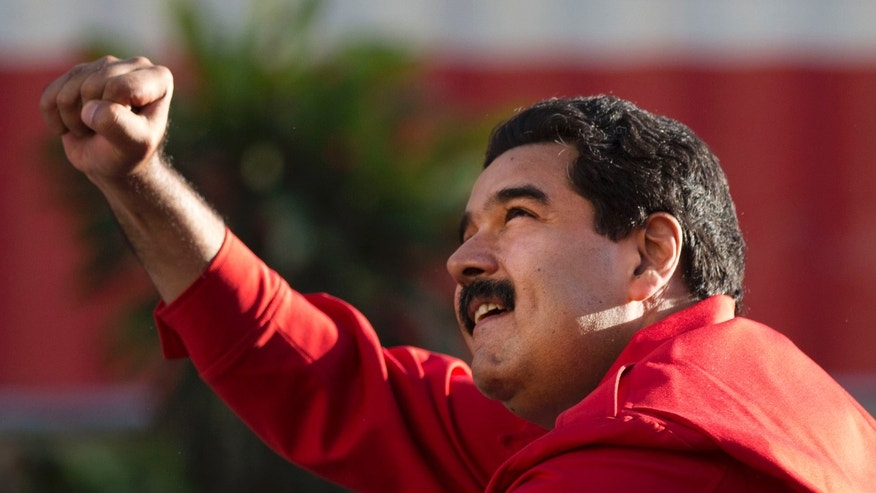 President Maduro gestures to supporters on Dec. 1, 2015, in the popular neighborhood of Petare, in Caracas.