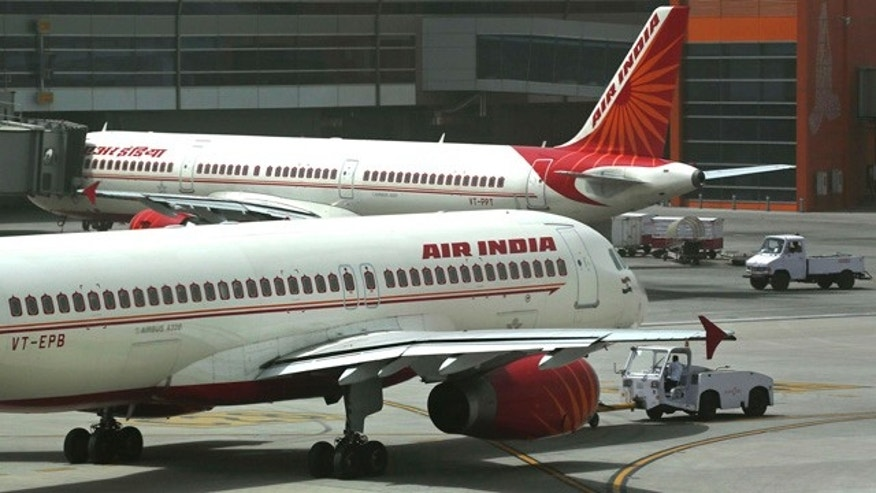 FILE - In this May 18, 2012, file photo, Air India planes are parked on the tarmac at the Terminal 3 of Indira Gandhi International Airport in New Delhi, India. (AP Photo/Kevin Frayer, File)