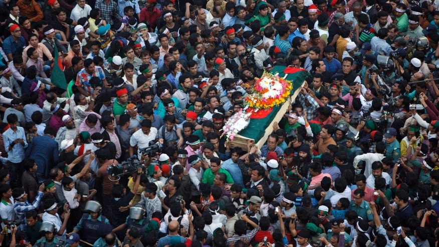 In this 2013 photo, mourners carry the coffin containing the body of blogger Rajib Haider in Bangladesh.