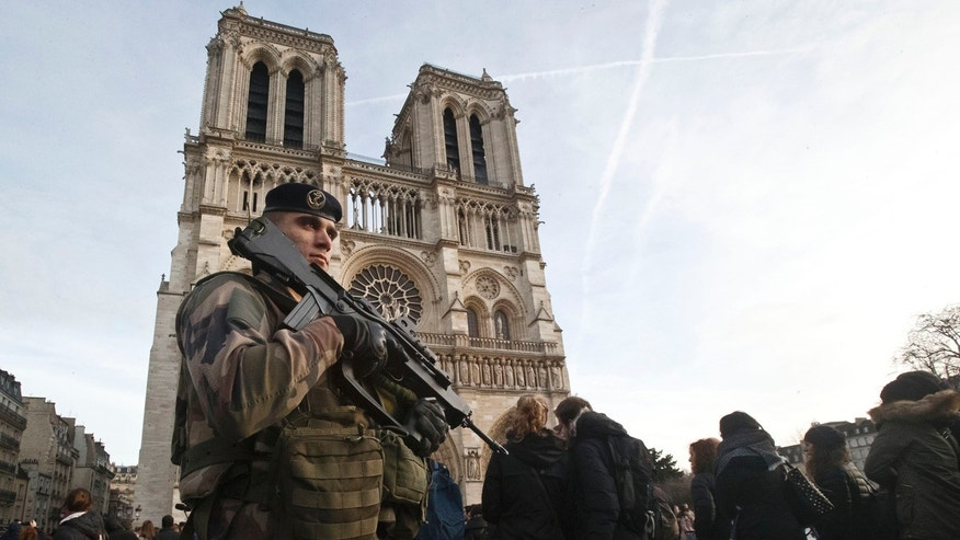 Dec. 30, 2015: A soldier patrols outside Notre Dame cathedral in Paris. (AP Photo/Michel Euler)