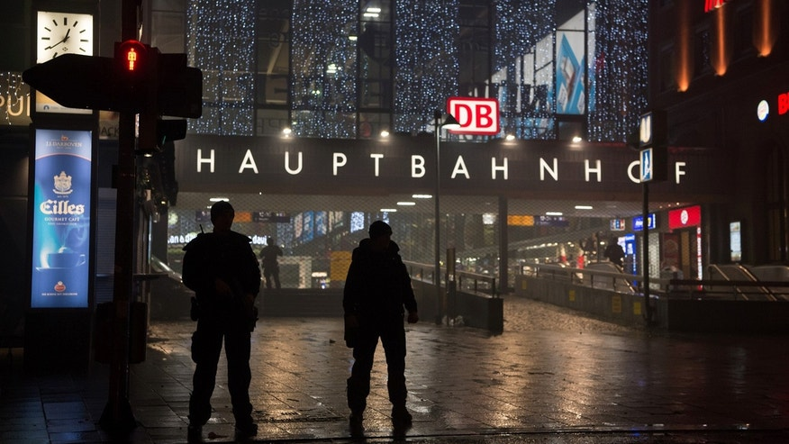 Dec. 31, 2015: German special police stand in front of the main train station in Munich after police warned of an 'imminent threat' of a terror attack and ordered two train stations to be cleared. (Sven Hoppe/dpa via AP)