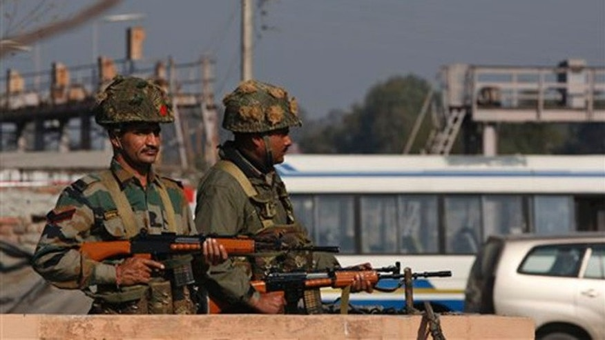 Jan. 2, 2015: Indian soldiers stand outside an Indian air force base in Pathankot, 267 miles north of New Delhi, India
