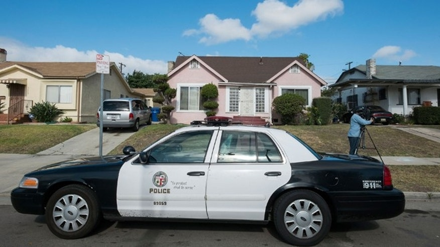 LOS ANGELES, CA - MAY 20: A police car sits parked in fromt of Michael Jace's home on May 20, 2014 in Los Angeles, California. The actor has been arrested for the murder of his wife .  (Photo by Valerie Macon/Getty Images)