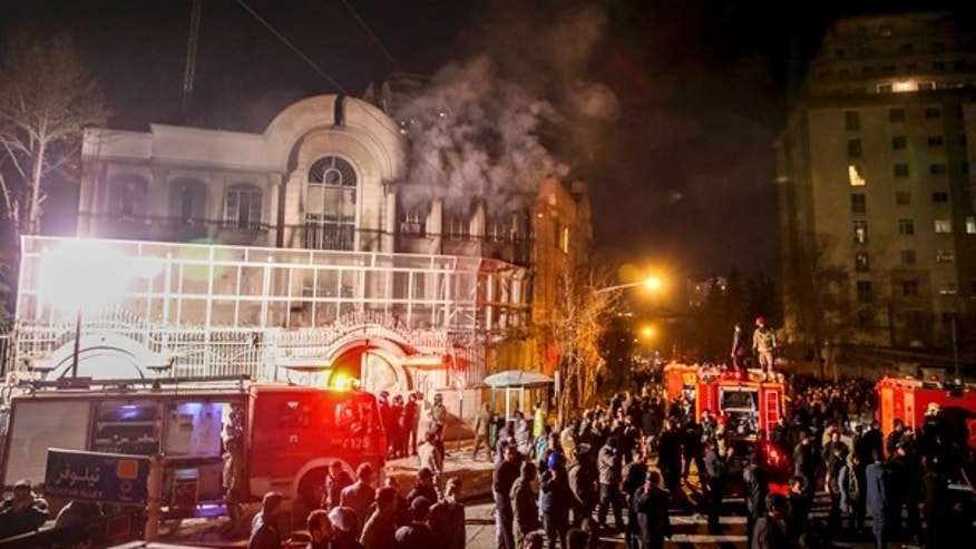 Jan. 3, 2016: Smoke rises as Iranian protesters set fire to the Saudi embassy in Tehran.
