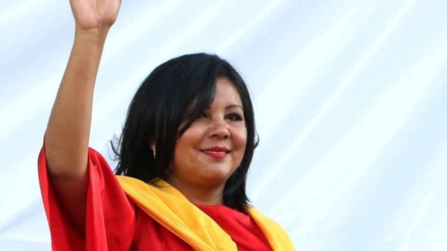 Jan. 1, 2016: Gisela Mota waves during her swearing in ceremony as mayor of Temixco, Morelos State, Mexico. (AP Photo/Tony Rivera)