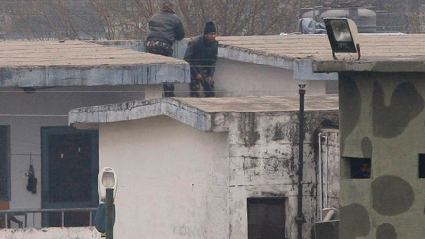 Jan. 4, 2014: Indian soldiers are seen on a rooftop at an airbase in Pathankot, India.