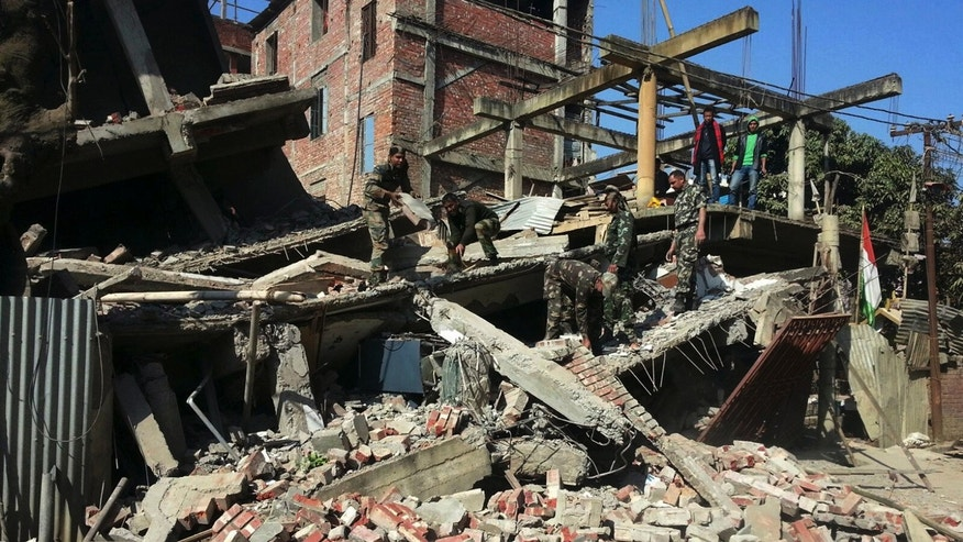 Jan. 4, 2016: Indian soldiers remove debris from a house that collapsed in an earthquake in Imphal, capital of the northeastern state of Manipur. (AP Photo/Worshon Ngashangva)