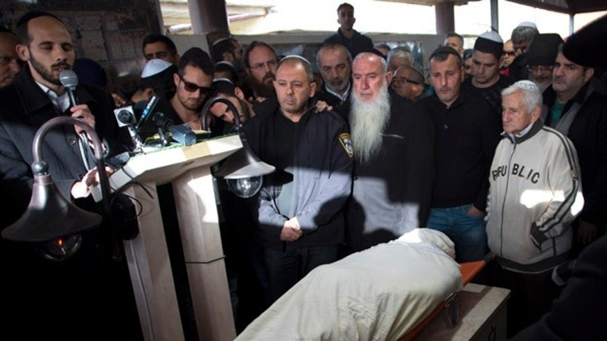 Jan. 3, 2016: Relatives and friends of Shimon Ruimi mourn during his funeral in the southern Israeli town of Ofakim. Ruimi, 30, was killed when a gunman opened fire outside a bar on a main street in Tel Aviv on Friday afternoon.
