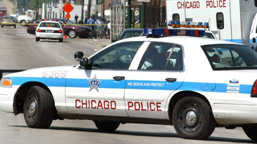 CHICAGO - AUGUST 27:  Chicago Police activity is seen near Windy City Core Supply Inc., an auto parts warehouse in which seven people, one of them being the gunman, were killed August 27, 2003 in Chicago. It is unknown whether the shooter was killed by police or took his own life in what police say was a workplace shooting.  (Photo by Tim Boyle/Getty Images)