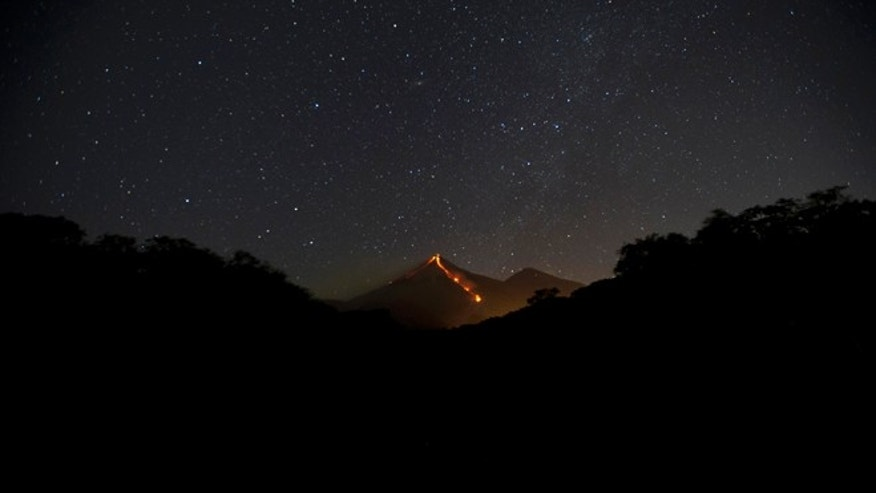 "The Volcano of Fire releases lava, seen from Escuintla, Guatemala, Monday, Jan. 4, 2016. Guatemalan authorities are on alert after the country's Volcano of Fire erupted in dramatic fashion on Sunday. Officials are asking nearby communities to remain vigilant amid a state of yellow alert. In Spanish it is known as ""El Volcán del Fuego."" (AP Photo/Moises Castillo)"