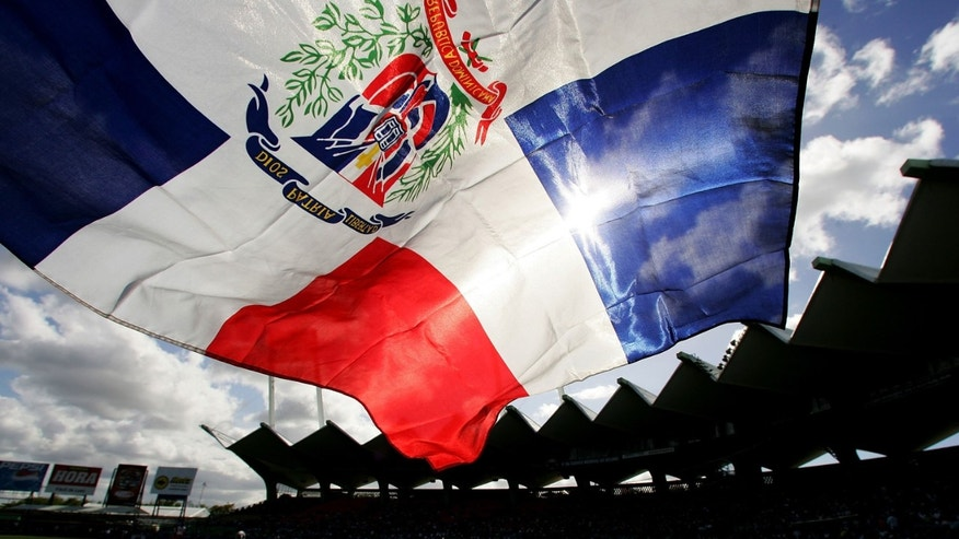 SAN JUAN, PUERTO RICO - MARCH 13:  A fan flies the Dominican Republic flag during the game against Cuba during Round 2 of the World Baseball Classic on March 13, 2006 at Hiram Bithorn Stadium in San Juan, Puerto Rico.  (Photo by Al Bello/Getty Images)