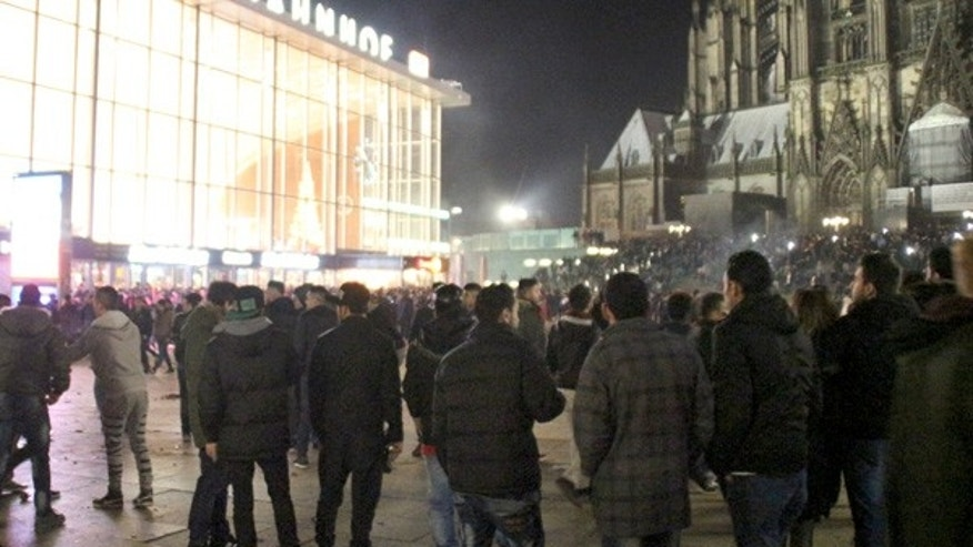 In this Dec. 31, 2015 picture, persons gather at the Cologne, Germany, main station