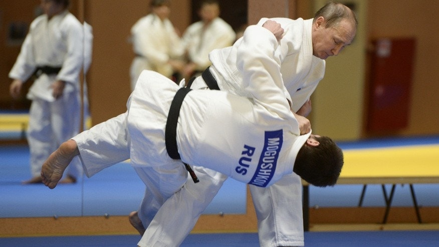 Jan. 8, 2016: Russian President Vladimir Putin, top, competes against Musa Mogushkov, member of Russia's national Judo team, during their training session in the resort city of Sochi, Russia.