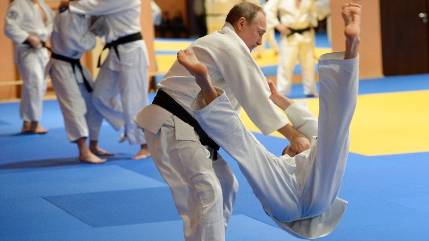 Jan. 8, 2016: Russian President Vladimir Putin, left, competes against Mikhail Pulyaev, member of Russia's national judo team.